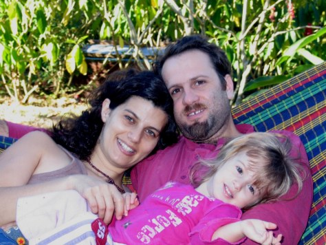 A family of three, Rod Bachar, Lilac and Ella rest in a hammock on Refugio de Los Angeles