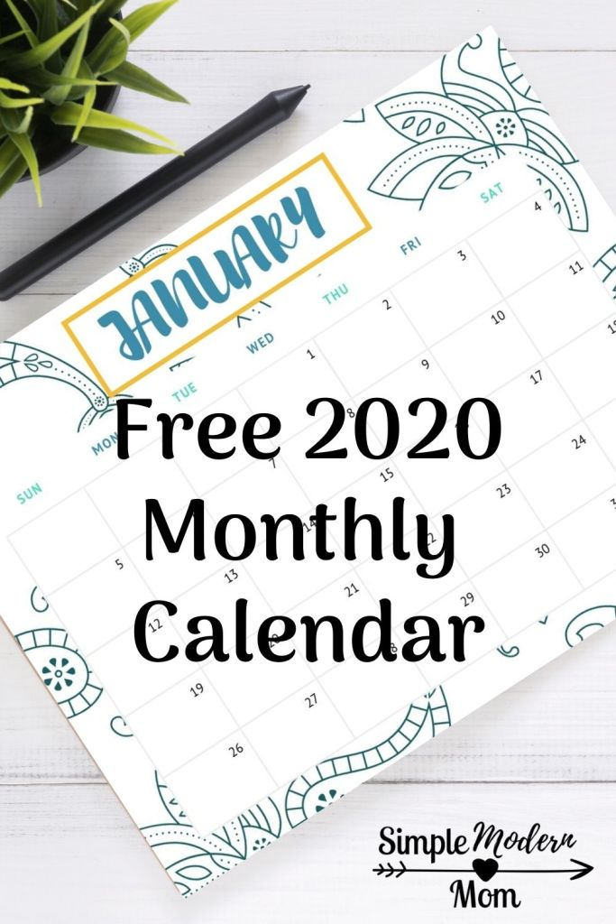 Monthly calendar, january 2020 laying on a desk with a pen and green plant. Free 2020 monthly calendar