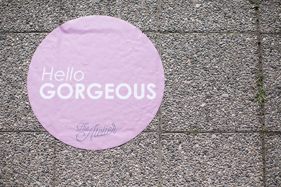 Floor Decal that reads Hello Gorgeous at The Atelier Collective
