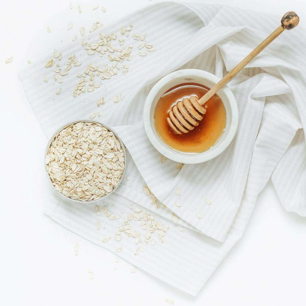 honey and oats in white bowls