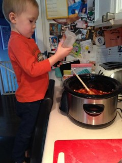 toddler learning to cook