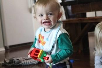 baby holding duplo lego