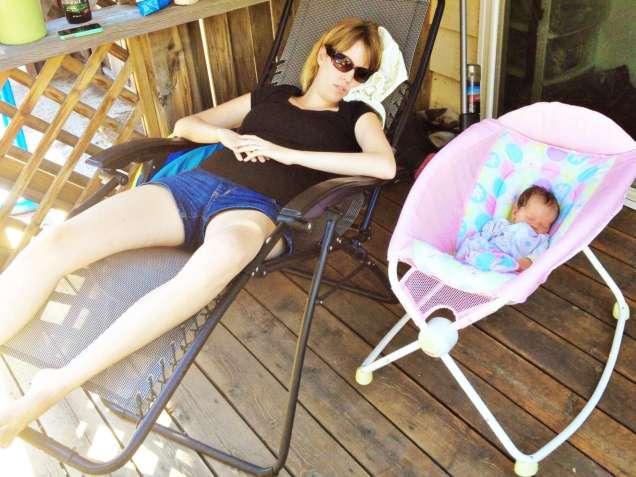 mom sleeping beside baby