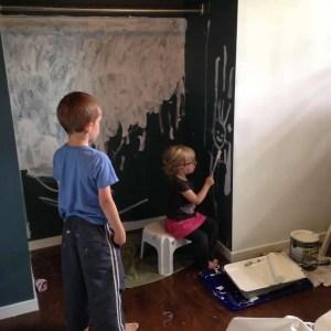 helping paint bedroom walls renovation