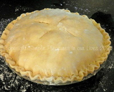Top with the remaining dough, crimp, cut four 2-inch slits, and sprinkle with turbinado sugar