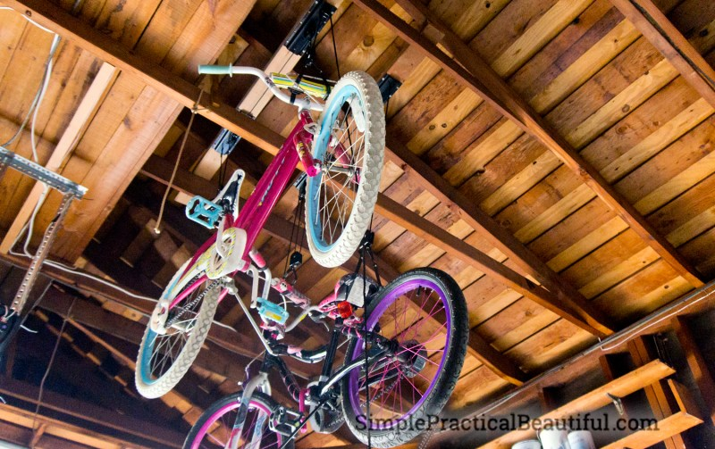 Two bikes stored using bicycle lifts