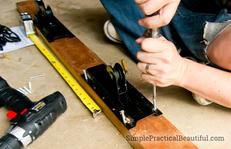 Attach the pulleys to the board with 6 screws