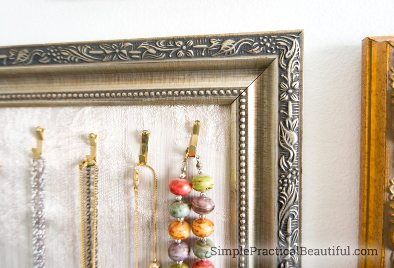 picture frame hooks holding necklaces