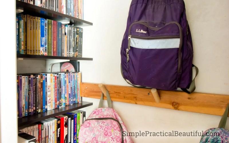 Entry closet media storage | SimplePracticalBeautiful.com