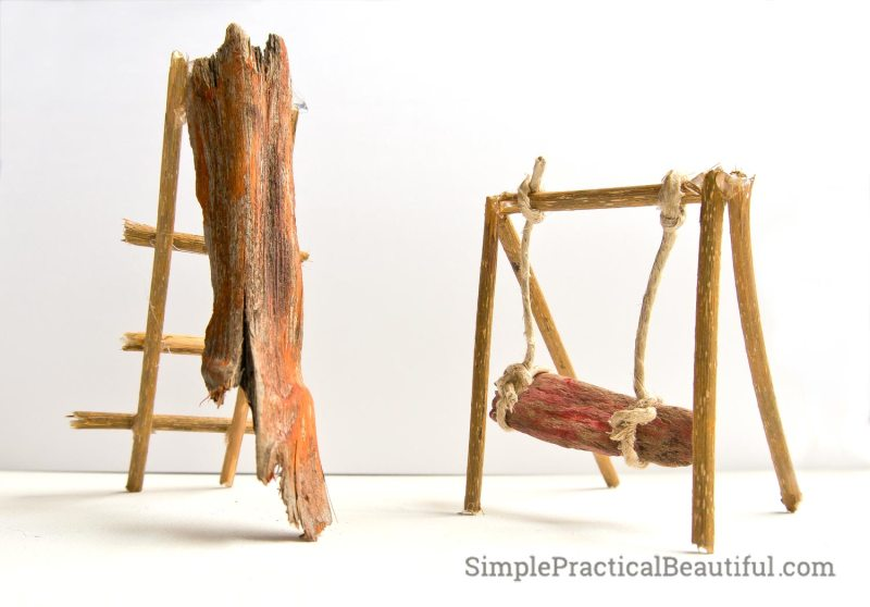 slide and swing built of sticks, wood chips, and hemp rope
