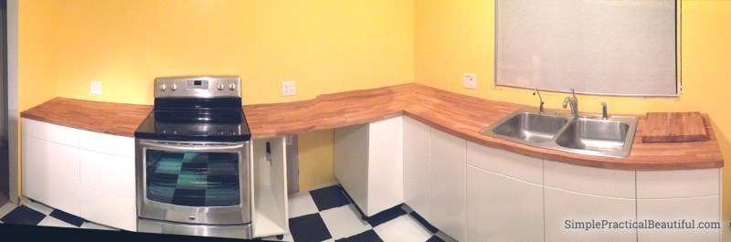 Before, after, and the progress of a midcentury kitchen remodel