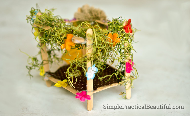 A diy fairy bed built from popsicle sticks.