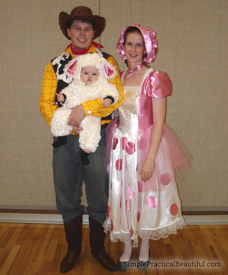 A family costume from Toy Story for Halloween, with Woody, Bo Peep, and her sheep
