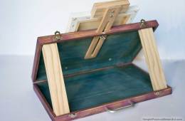 Build a portable DIY artist easel with space to store paints out of an old wood suitcase