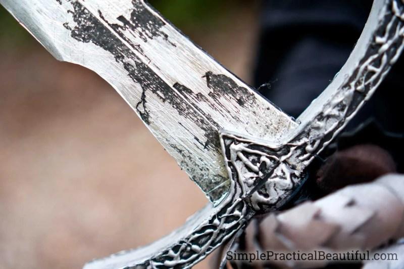 Details of the wood sword painted to look like metal