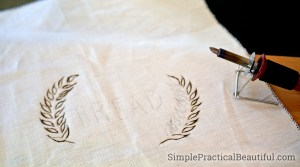 Wood burning on fabric, a linen bread bag