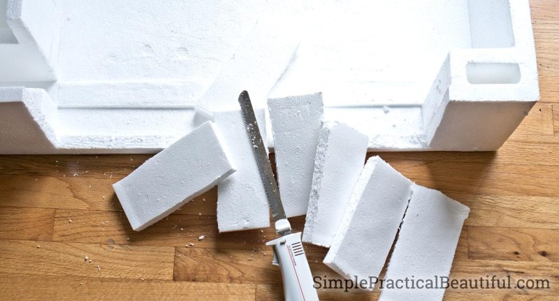 Cut styrofoam with an electric knife to use as filler and secure the base inside the new pot