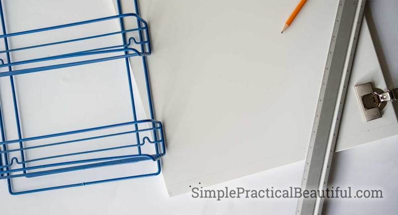 Measuring a cabinet door to make alterations to a kitchen cabinet