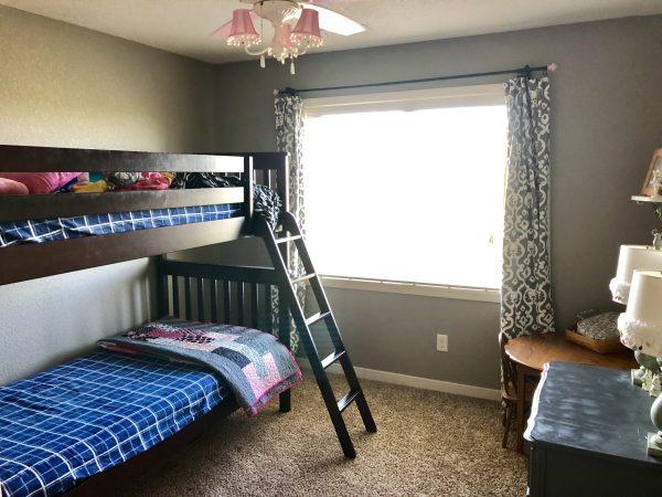 bunk beds in shared kids bedroom