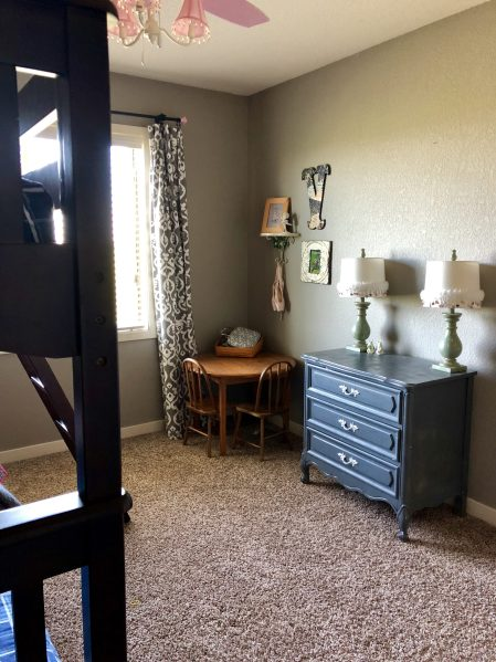 grey dresser and kids table in kids shared bedroom