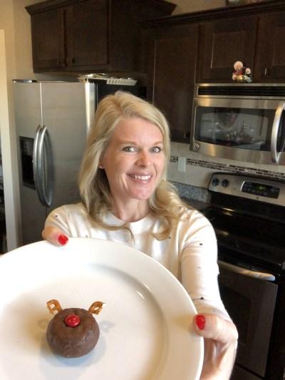 woman holding reindeer doughnut