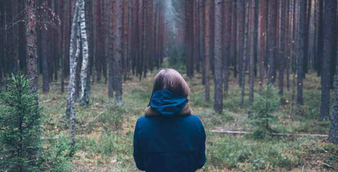 Woman looking at forest