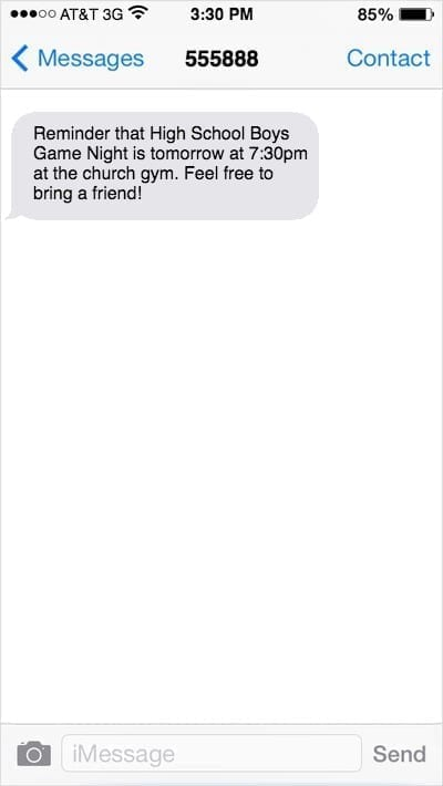 iPhone screen with reminder text about high school boys game night at church gym