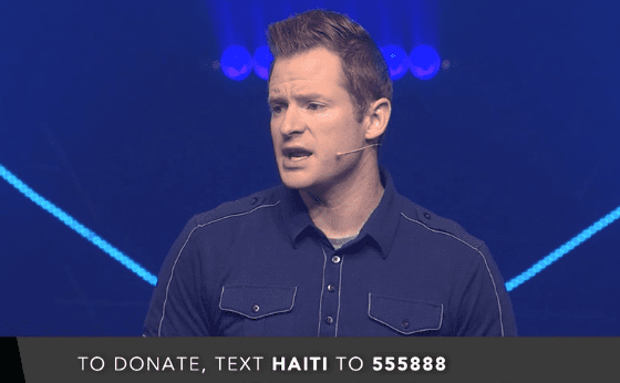 Picture of pastor speaking with text message invitation to donate to Haiti work