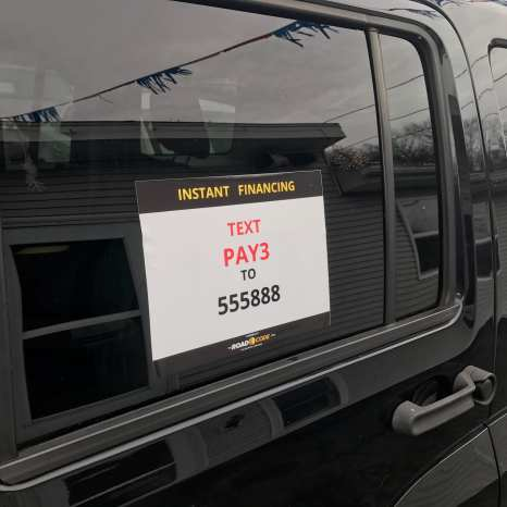 Sign in window of black vehicle, Instant Financing, Text PAY3 to 555888