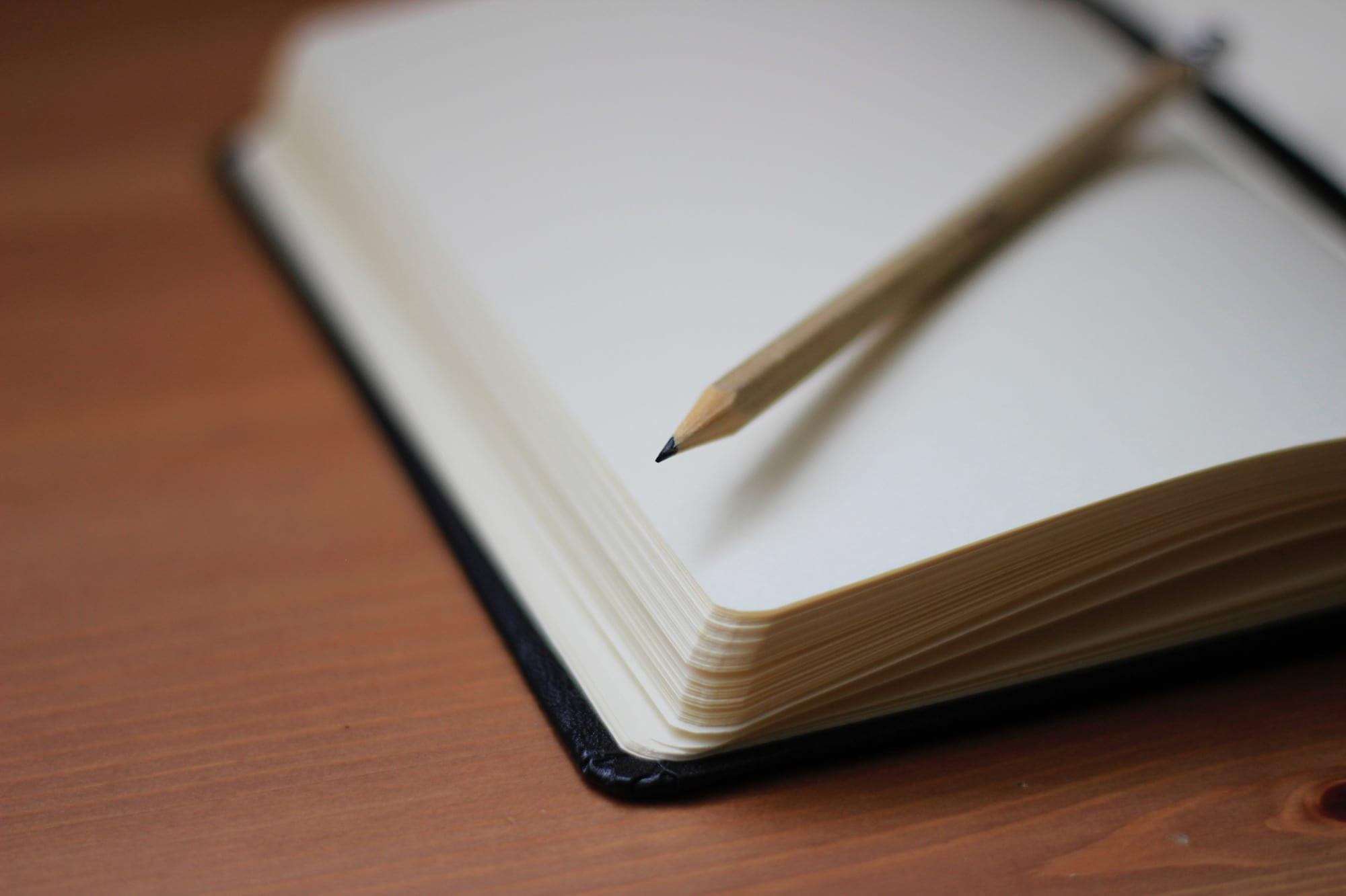 Closeup of pencil on open notebook