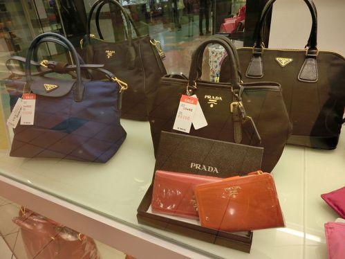 HK_上環_Sheung_Wan_信德中心_Shun_Tak_Centre_window_shop_Handbags_Prada_Mar-2013