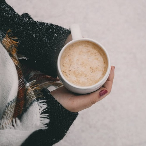 woman holding a mug of hot chocolate