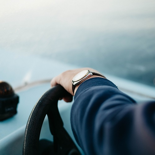 person steering boat