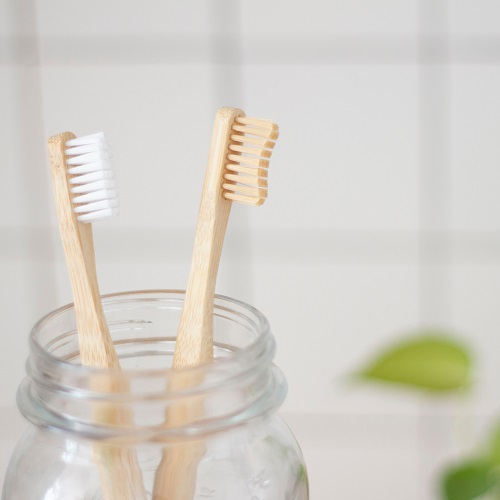 wooden toothbrushes in mason jar