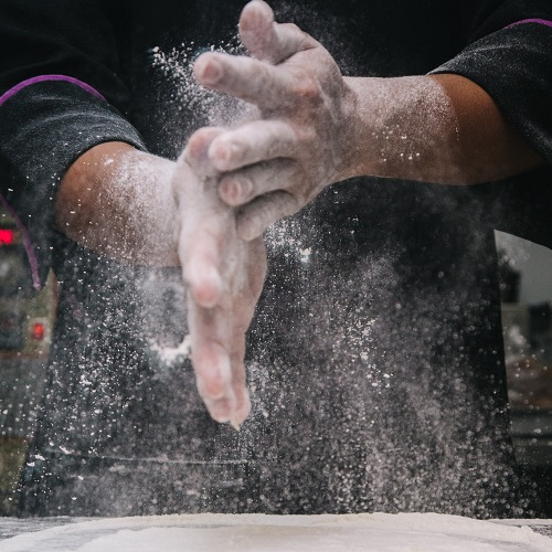 man kneading dough