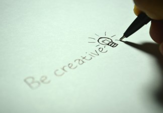 'Be creative' written with a pen