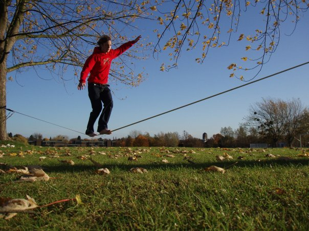 A student slacklining at the University of Cambridge
