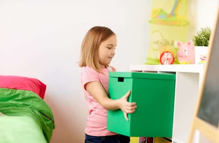 A child decluttering and organizing their toys