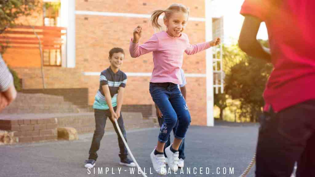Kids playing jump rope and singing jump rope songs