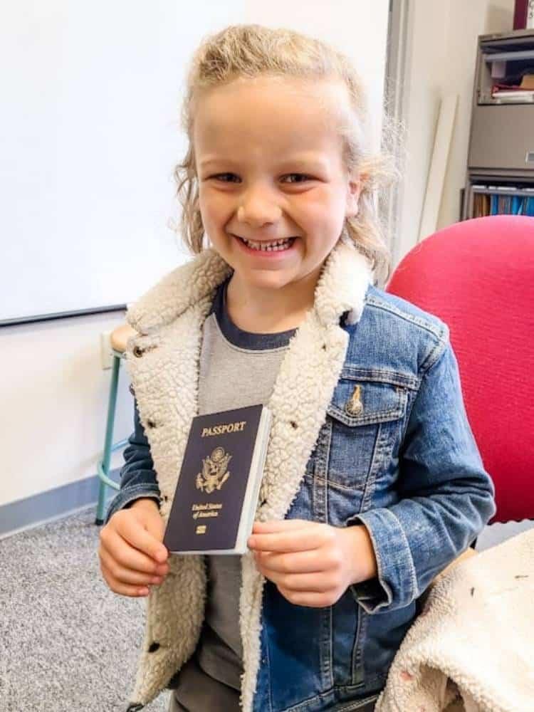 Little boy holding a passport
