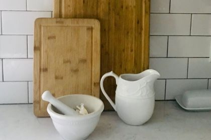 wood cutting boards, white ceramic creamer and bowl