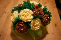 Cupcake Bouquet of chocolate and vanilla cupcakes, with rose frosting.