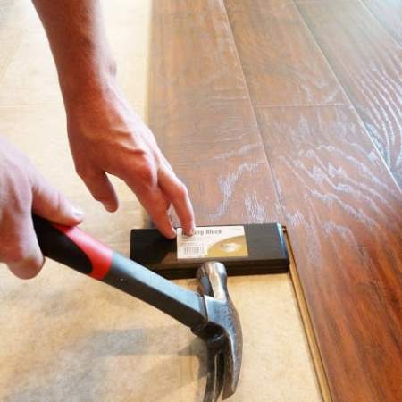 How to Install Floating Laminate Wood Flooring {Part 2}:  The Installation