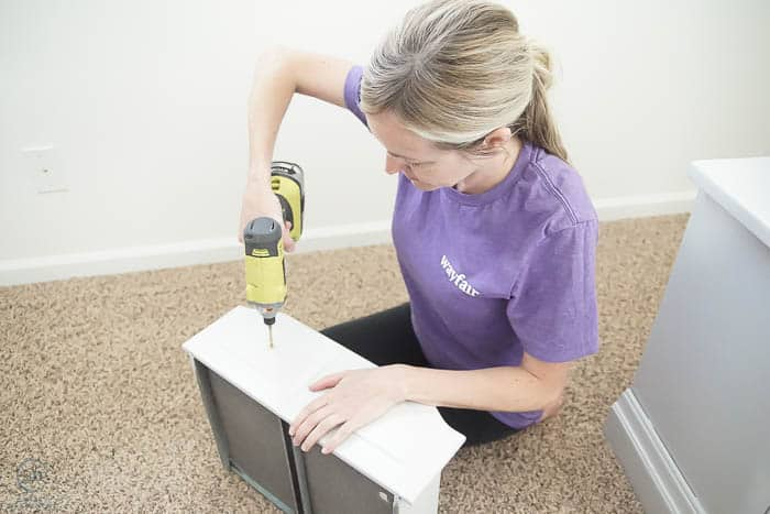 Drill holes for hardware in nightstands