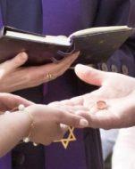 Rev. Akasha Lonsdale, Interfaith Minister and Celebrant blesses the wedding rings