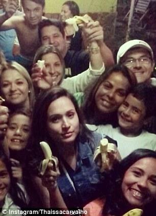 Alves' girlfriend with a banana