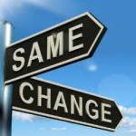 "two directional signs: one says ""same"" and the other says ""change"""