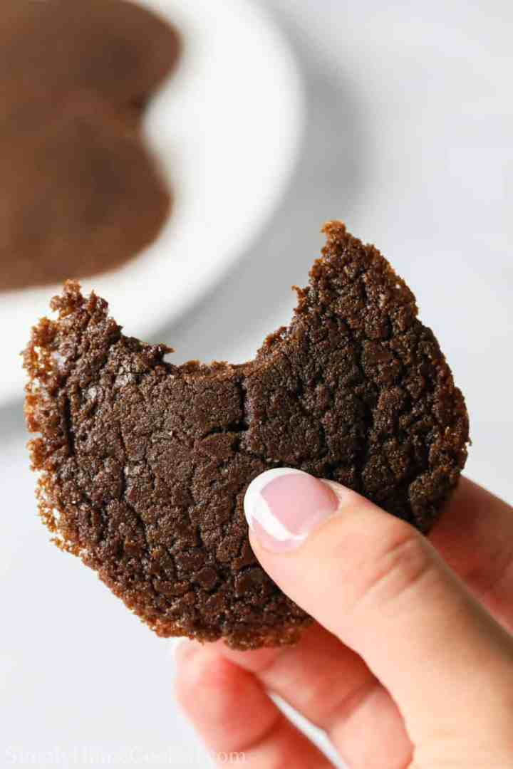close up photo of a hand holding a bitten Nutella cookie