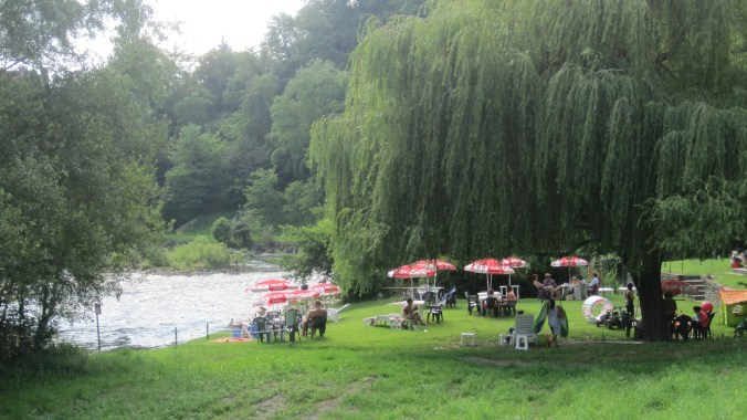 Public bathing beach along the river Rave d'Orlonge with a little restaurant close by