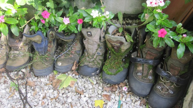 Shoes left in the refuge used as flowerpots